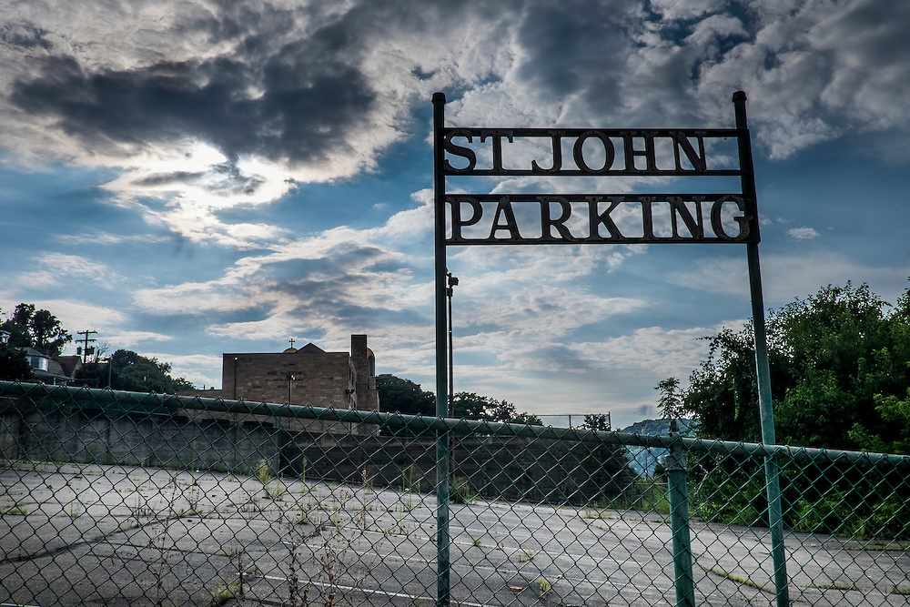 A parking lot for St. John the Divine Russian Orthodox Church.<br /> <br /> Monessen, a third-class city, faces the same problems as th other former steel towns &mdash; declining population and tax revenue after the mills shut down. The city's population has dropped to 7,600 from a high of 20,268 in 1930.