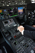 Boeing pilot sits in glass cockpit of the 787 Dreamliner (N787BX) at the Farnborough Airshow.