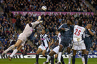 Photo: Glyn Thomas.<br />West Bromwich Albion. Newcastle Utd. The Barclays Premiership. 30/10/2005.<br /> West Brom's keeper Tomasz Kuszczak (L) makes a superb save to deny Newcastle.