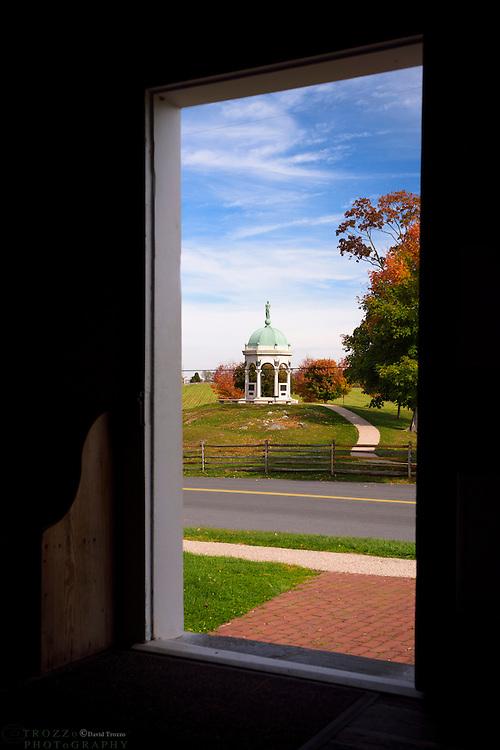 The Maryland Memorial, Antietam National Battlefield, Sharpsburg, Maryland, USA seen through the door of Dunker Church.