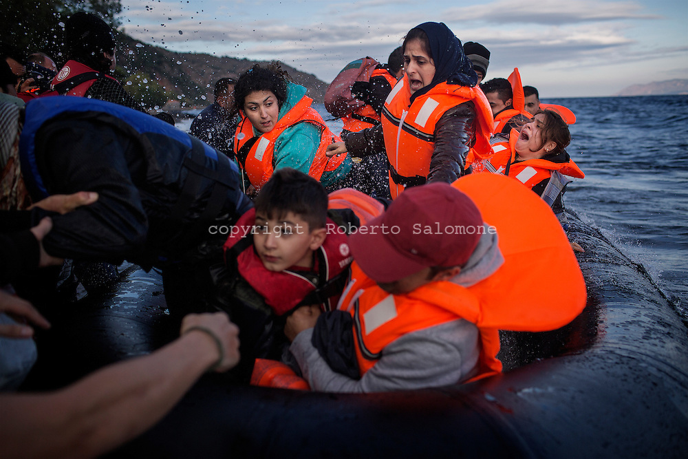 Greece, Lesvos - Refugees reach the shores of the Greek island of Lesvos in the Aegean Sea. Migrants  leave on dinghies from Turkey to reach Lesvos. Since the beginning of 2015 some 185.000 refugees reached the island.