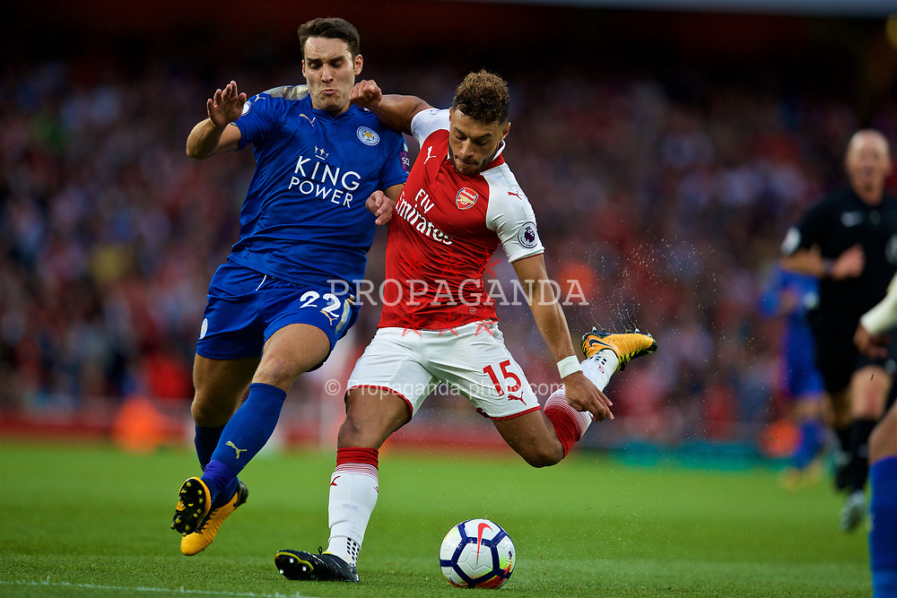 LONDON, ENGLAND - Friday, August 11, 2017: Arsenal's Alex Oxlade-Chamberlain and Leicester City's Matty James during the FA Premier League match between Arsenal and Leicester City at the Emirates Stadium. (Pic by David Rawcliffe/Propaganda)
