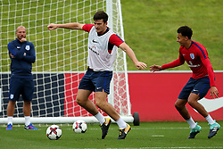 England's Harry Maguire takes on Dele Alli - Mandatory by-line: Matt McNulty/JMP - 29/08/2017 - FOOTBALL - St George's Park National Football Centre - Burton-upon-Trent, England - England Training and Press Conference