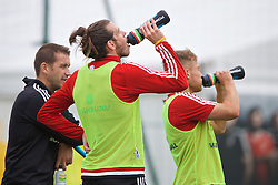 DINARD, FRANCE - Wednesday, June 29, 2016: Wales' Gareth Bale drinks from a Powerade bottle during a training session at their base in Dinard as they prepare for the Quarter-Final match against Belgium during the UEFA Euro 2016 Championship. (Pic by David Rawcliffe/Propaganda)