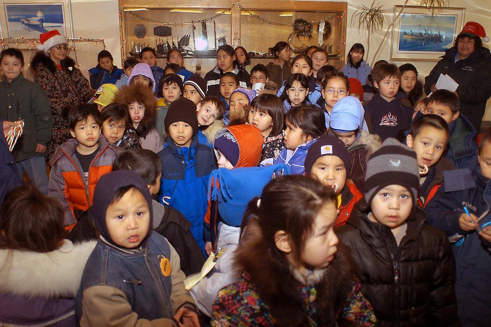 Alaska, Barrow. Elementary school kids sing Christmas carrols. December 2003