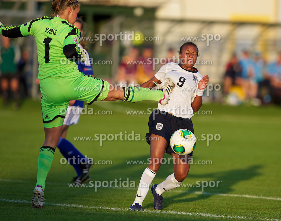 28.08.2013, Richmond Park, Carmarthen, ENG, UEFA Damen U19 EM, England vs Finnland, im Bild England's Nikita Parris is fouled by Finland's goalkeeper Vera Varis for a penalty during the Semi-Final match of the UEFA Women's Under-19 Championship Wales 2013 tournament at Richmond Park. during the UEFA women U 19 championchip group A match between England and Finland at Richmond Park in Carmarthen, Great Britain on 2013/08/28. EXPA Pictures &copy; 2013, PhotoCredit: EXPA/ Propagandaphoto/ David Rawcliffe<br /> <br /> ***** ATTENTION - OUT OF ENG, GBR, UK *****