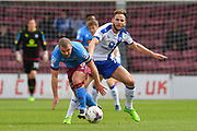 Scunthorpe United midfielder Stephen Dawson (8) and Chesterfield FC midfielder Dan Gardner (7) during the EFL Sky Bet League 1 match between Scunthorpe United and Chesterfield at Glanford Park, Scunthorpe, England on 17 April 2017. Photo by Ian Lyall.