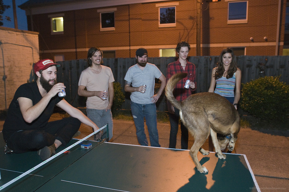 Houndmouth relaxes outside after practicing unreleased material at the Green House, Friday, Aug. 17, 2012 in New Albany, Ind.  Houndmouth is: bassist Zak Appleby, guitarist Matt Myers, keyboardist Katie Toupin and drummer Shane Cody, foreground. (Photo by Brian Bohannon)