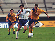 09.09.1992, Olympic Stadium, Helsinki, Finland..FIFA World Cup 1994 Qualifying match, Finland v Sweden..Jari Litmanen (Finland) v Patrik Andersson (Sweden).©JUHA TAMMINEN