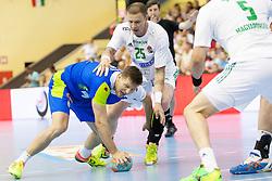 during handball match between National teams of Slovenia and Hungary in play off of 2015 Men's World Championship Qualifications on June 15, 2014 in Rdeca dvorana, Velenje, Slovenia. Photo by Urban Urbanc / Sportida