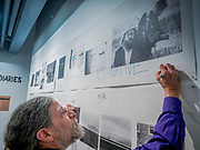 "Portland, Oregon, USA. 26 FEB, 2018. Blue Sky Gallery co-founder Christopher Rauschenberg, son of the American painter Robert Rauschenberg, defaces a Robert Frank image of the poet Alan Ginsberg  at Blue Sky Gallery in Portland, Oregon, USA. The work was destroyed in a ""Destruction Dance"" performance defacing the photographs with ink and mutilation with scissors, knives and even ice skates  at the end of it's run. The destruction was Frank's protest regarding today's greed in the global art market."