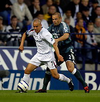 Fotball<br /> England 2005/2006<br /> Foto: SBI/Digitalsport<br /> NORWAY ONLY<br /> <br /> Bolton Wanderers v Newcastle United. The Barclays Premiership. 24/08/2005.<br /> <br /> Bolton's Stelios Giannakopoulos (L) makes his first premiership start of the season amidst transfer speculation as he holds off Newcastle's Stephen Carr