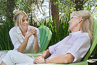 Mature woman and mother having a quality time at park