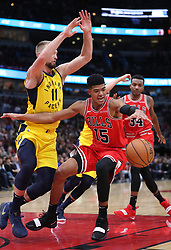 November 2, 2018 - Chicago, IL, USA - The Chicago Bulls' Chandler Hutchison (15) loses the ball as the Indiana Pacers' Domantas Sabonis (11) defends in the second quarter at the United Center in Chicago on Friday, Nov., 2, 2018. The Pacers won, 107-105. (Credit Image: © John J. Kim/Chicago Tribune/TNS via ZUMA Wire)