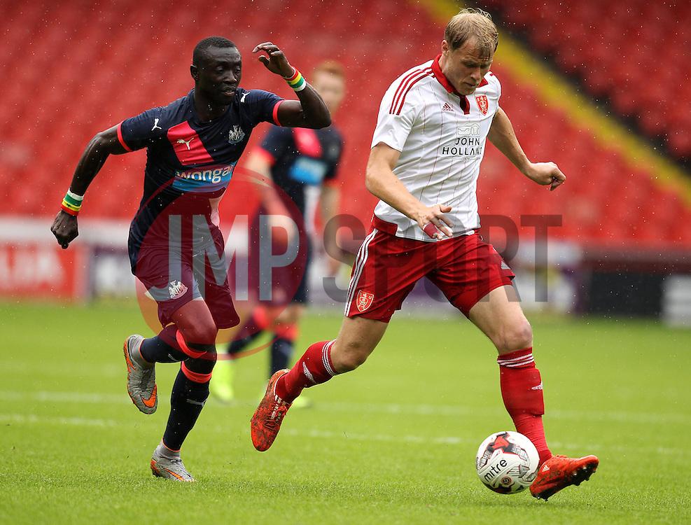 Sheffield United's Jay McEveley is chased down by Newcastle United's Papiss Cisse - Mandatory by-line: Robbie Stephenson/JMP - 26/07/2015 - SPORT - FOOTBALL - Sheffield,England - Bramall Lane - Sheffield United v Newcastle United - Pre-Season Friendly