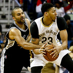Mar 3, 2016; New Orleans, LA, USA; San Antonio Spurs guard Tony Parker (9) fouls New Orleans Pelicans forward Anthony Davis (23) during the second half of a game at the Smoothie King Center. The Spurs defeated the Pelicans 94-86. Mandatory Credit: Derick E. Hingle-USA TODAY Sports