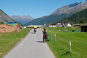 cycling the Inn river near Zuoz, Maloja Region, Graubünden, Switzerland