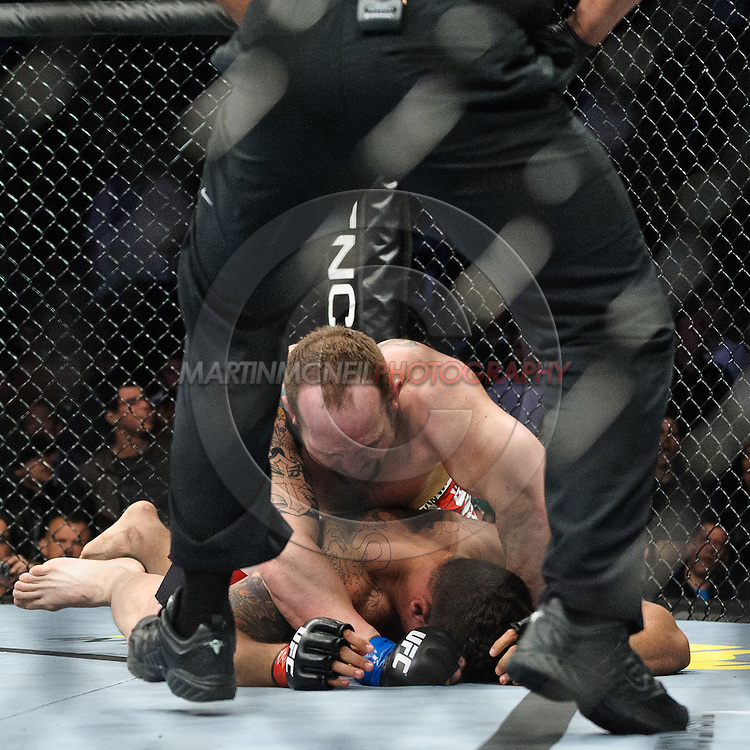 "NEWARK, NEW JERSEY, MARCH 27, 2010: Shane Carwin (top) pounds on a grounded Frank Mir during their bout at ""UFC 111: St. Pierre vs. Hardy"" in the Prudential Center, New Jersey on March 27, 2010"