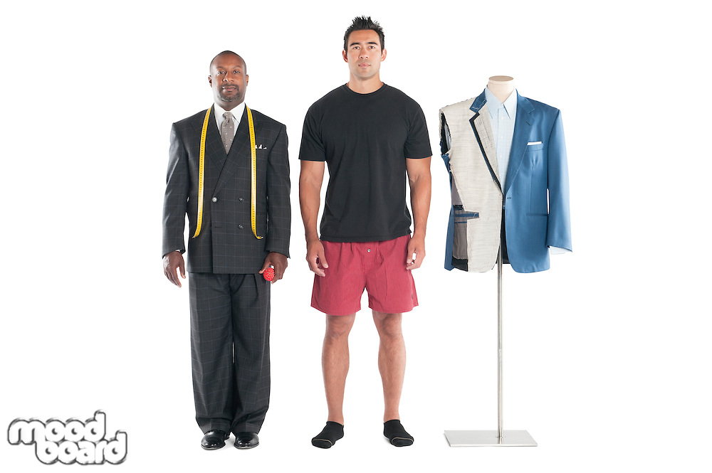 Portrait of tailor standing with customer over white background