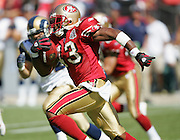 SAN FRANCISCO - SEPTEMBER 17:  Kick returner Maurice Hicks #43 of the San Francisco 49ers runs through a pack of defenders against the St. Louis Rams at Monster Park on September 17, 2006 in San Francisco, California. The Niners defeated the Rams 20-13. ©Paul Anthony Spinelli *** Local Caption *** Maurice Hicks