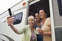 Ladies in RV Using Camera Phone