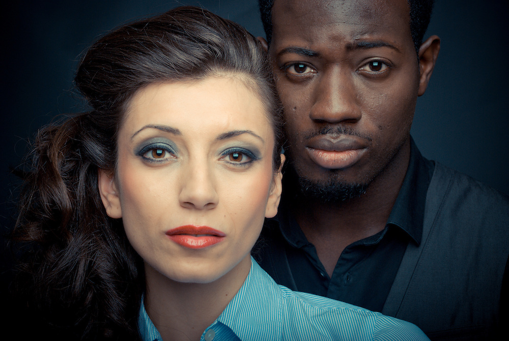 Corporate Portrait of a Woman and her Partner. It captures the confidence of the woman and the support of her partner.