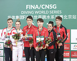 BEIJING, March 9, 2019  Lian Junjie (3rd L) and Si Yajie (3rd R) of China react during the awarding ceremony for mixed 10m synchronised at the FINA Diving World Series 2019 at the National Aquatics Center in Beijing, capital of China, March 9, 2019. (Credit Image: © Xinhua via ZUMA Wire)