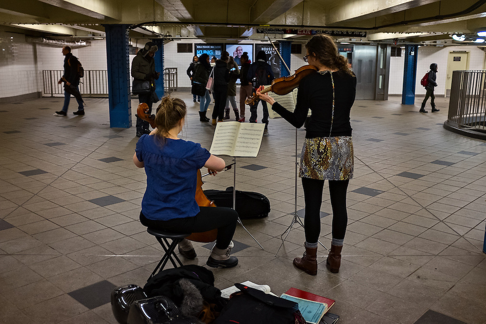 Violinist and cellist playing in Columbus Circle subway station, New York, NY, US