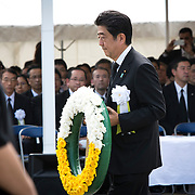 NAGASAKI, JAPAN - AUGUST 9 : Japanese Prime Minister Shinzo Abe walks with the wreath to offer for the atomic bomb victims in front of the Peace Statue in Nagasaki Peace Park, Nagasaki, southern Japan, Tuesday, August 9, 2016. Japan marked the 71st anniversary of the atomic bombing on Nagasaki. On August 9, 1945, during World War II, the United States dropped the second Atomic bomb on Nagasaki city, killing an estimated 40,000 people which ended World War II. (Photo by Richard Atrero de Guzman/NURPhoto)