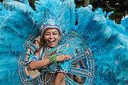 A feathered dancer laughs during an arts festival. The Dream Parade is an annual arts carnival and street parade that takes place in Taipei. The event is the brainchild of real estate developer Gordon Tsai who founded the Dream Community after being inspired by simialr events in other parts of the world.