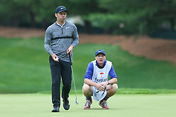 June 23, 2018 - Cromwell, Connecticut, United States - Paul Casey (L) and his caddie line up a putt on the 8th green during the third round of the Travelers Championship at TPC River Highlands. (Credit Image: © Debby Wong via ZUMA Wire)