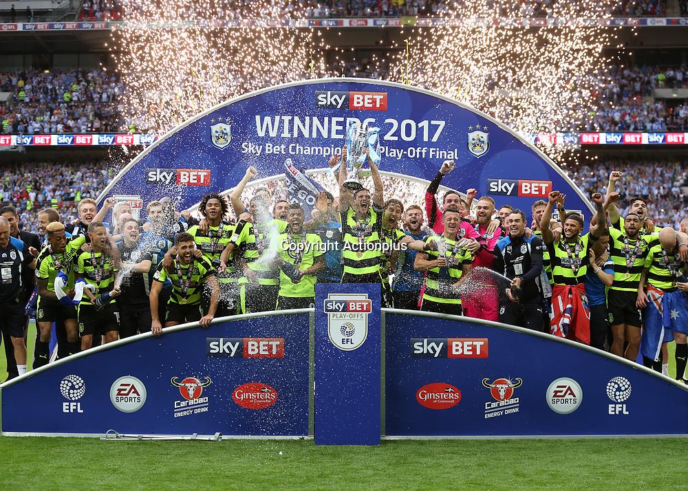 May 29th 2017, Wembley Stadium, London, England; EFL Championship playoff final, Huddersfield Town versus Reading; Mark Hudson of Huddersfield Town lifts the EFL Championship playoff final trophy