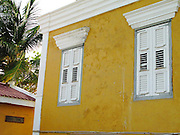 Yellow building with white shutter