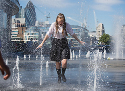 Image ©Licensed to i-Images Picture Agency. 03/07/2014. London, United Kingdom. School girls play with water coming out of groundlevel fountains in one of the warmest days of the year with 28ºC in the shade. More London Riverside, City Hall area. Picture by Daniel Leal-Olivas / i-Images