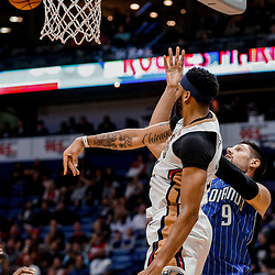 Oct 30, 2017; New Orleans, LA, USA; New Orleans Pelicans forward Anthony Davis (23) blocks a shot attempt by Orlando Magic center Nikola Vucevic (9) during the first quarter of a game at the Smoothie King Center. Mandatory Credit: Derick E. Hingle-USA TODAY Sports