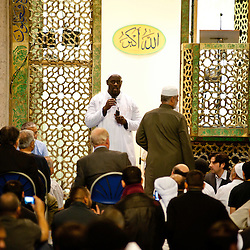 London, UK - 21 July 2012: Team GB Olympic discus thrower Abdul Buhari gives a speech during a prayer for the breaking of the fast during the Ramadan Iftar 2012 celebrations hosted at the London Central Mosque in Regents Park.