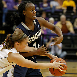 November 16, 2011; Baton Rouge, LA; LSU Tigers guard Jeanne Kenney (5) and Georgetown Hoyas guard Sugar Rodgers (14) scramble for a loose ball during the second half of a game at the Pete Maravich Assembly Center. LSU defeated Georgetown 51-40. Mandatory Credit: Derick E. Hingle-US PRESSWIRE