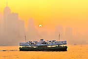 Star Ferry traveling across Hong Kong Victoria Harbour.