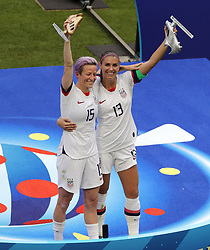 USA's Megan Rapinoe receives the The Golden Ball and USA's Alex Morgan with The Silver Boot after the FIFA Women's World Cup 2019