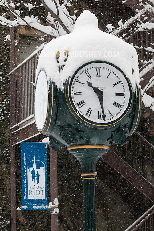 Middletown, New York - The clock by Something Sweet during a snowstorm on Feb. 9, 2017.