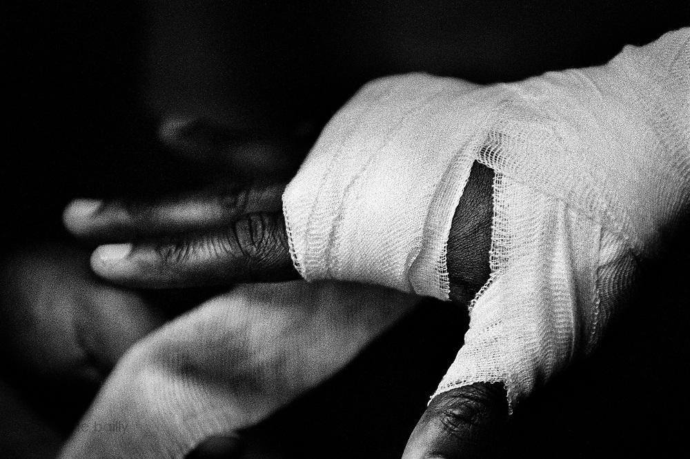 Diferson Legrand, from Gym U, is having his hand wrapped by his coach before the 2005 Daily News Golden Gloves 165-pound open quarterfinals fight against Hajro Sujak at the Queens PAL on March 10th.
