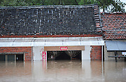 JINHUA, CHINA - JUNE 22: (CHINA OUT) <br /> <br /> Floods In China<br /> <br />  The picture shows the flooded area of Lanxi city (a county-level city under the administration of the prefecture-level city Jinhua) after hit by torrential rains at Chakou village on June 22, 2014 in Jinhua, Zhejiang province of China. China\'s Lanxi city has came across the first flood peak of 2014 on June 22 with the warning water level of 29.65 meters.<br /> ©Exclusivepix