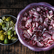 Red onion and lemon wedges are the 'salt & pepper' on tha table of a street restaurant in Ahmedabad, Gujarat.