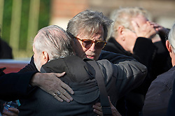 © London News Pictures. 05/11/2014. ERIC CLAPTON hugs Creme lyricist PETE BROWN, while attending the funeral of Jack Bruce at Golders Green Crematorium in North London. Jack Bruce was the lead singer and bass player for British Rock band Creme, alongside Eric Clapton and Ginger Baker. Creme sold over 15 million albums worldwide and were widely considered to be the worlds first successful supergroup. Photo credit : Ben Cawthra/LNP