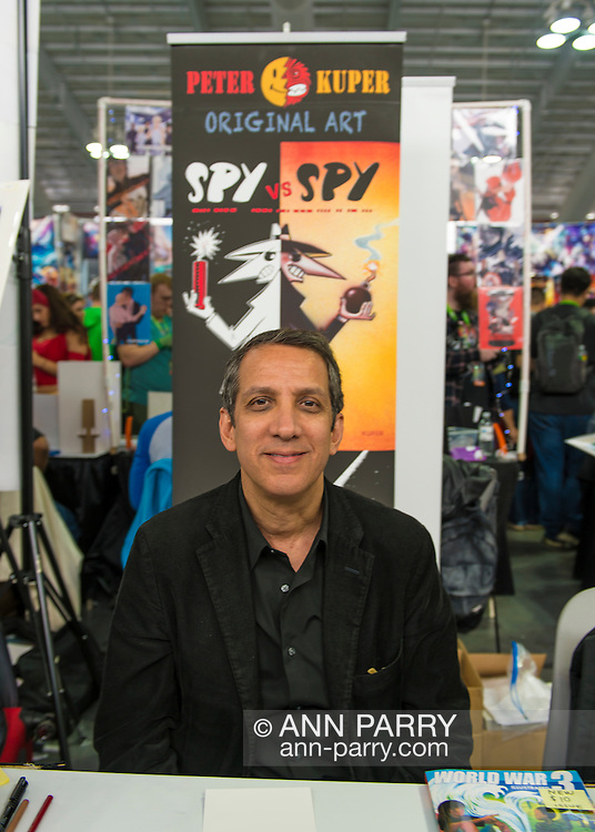 Manhattan, New York City, New York, USA. October 10, 2015. PETER KUPER, the artist of the comic strip SPY VS SPY in Mad magazine since 1997 is at his table at Artist Alley at the 10th Annual New York Comic Con. NYCC 2015 is expected to be the biggest one ever, with over 150,000 attending during the 4 day ReedPOP event, from October 8 through Oct 11, at Javits Center in Manhattan