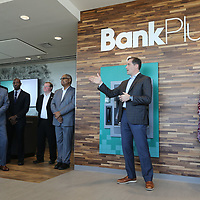 Brent Waldrop, center, welcomes guests and others as Bank Plus opens it's newest location on North Gloster Friday morning.