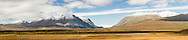 Composite panorama of Landmark Gap with Mount Moffit and McGinnis Peak of the Alaska Range seen through the gap along the Denali Highway in Southcentral Alaska. Autumn. Afternoon.