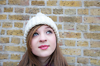 Close-up of beautiful young woman looking up