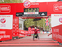 Raymond Martin of the USA crosses the line to finish first in the IPC Athletics Marathon World Championships T51/52 wheelchair race at the Virgin Money London Marathon, Sunday 26th April 2015.<br /> <br /> Scott Heavey for Virgin Money London Marathon<br /> <br /> For more information please contact Penny Dain at pennyd@london-marathon.co.uk