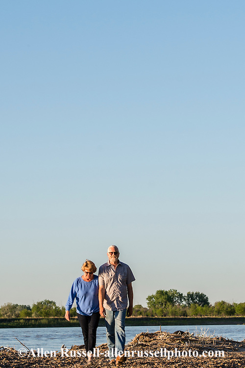 Kevin and Karen Boehler, evening walk on their farm, Yellowstone River, east of Fairview Montana, near its confluence with the Missouri River